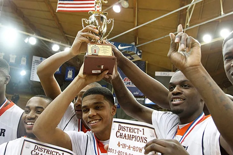Chester celebrates with its trophy after defeating Pennsbury. (Ron Cortes/Staff Photographer)