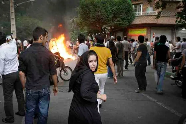 Reformists battled police with stones and gas bombs in Tehran, Iran, in June 2009. Saturday marked the first anniversary of the disputed reelection of President Mahmoud Ahmadinejad.