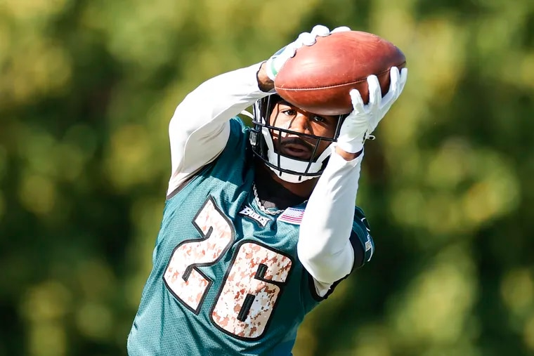 Eagles running back Miles Sanders catches the football.