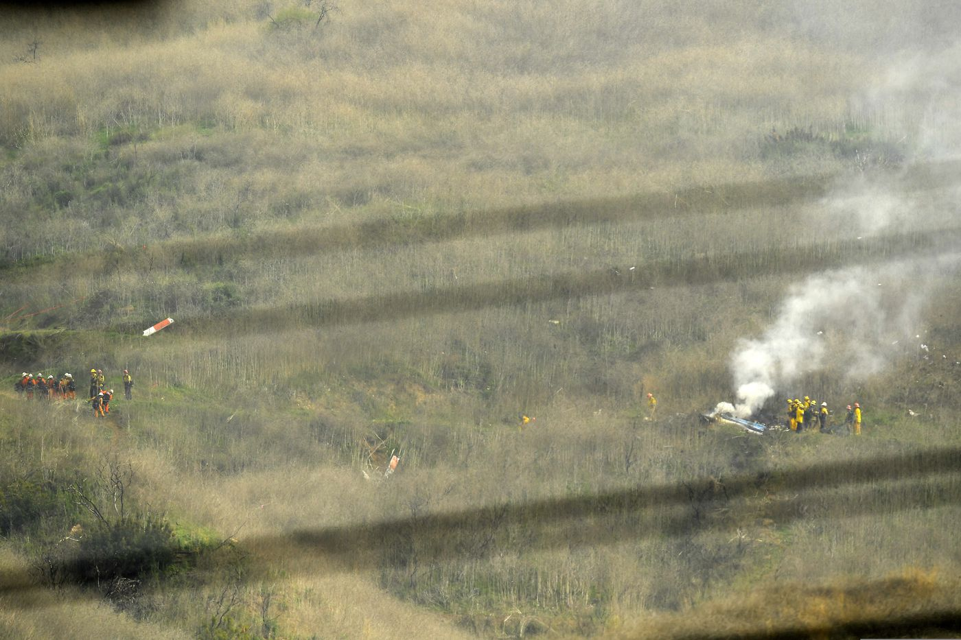 Firefighters work at the scene of the crash site Sunday.