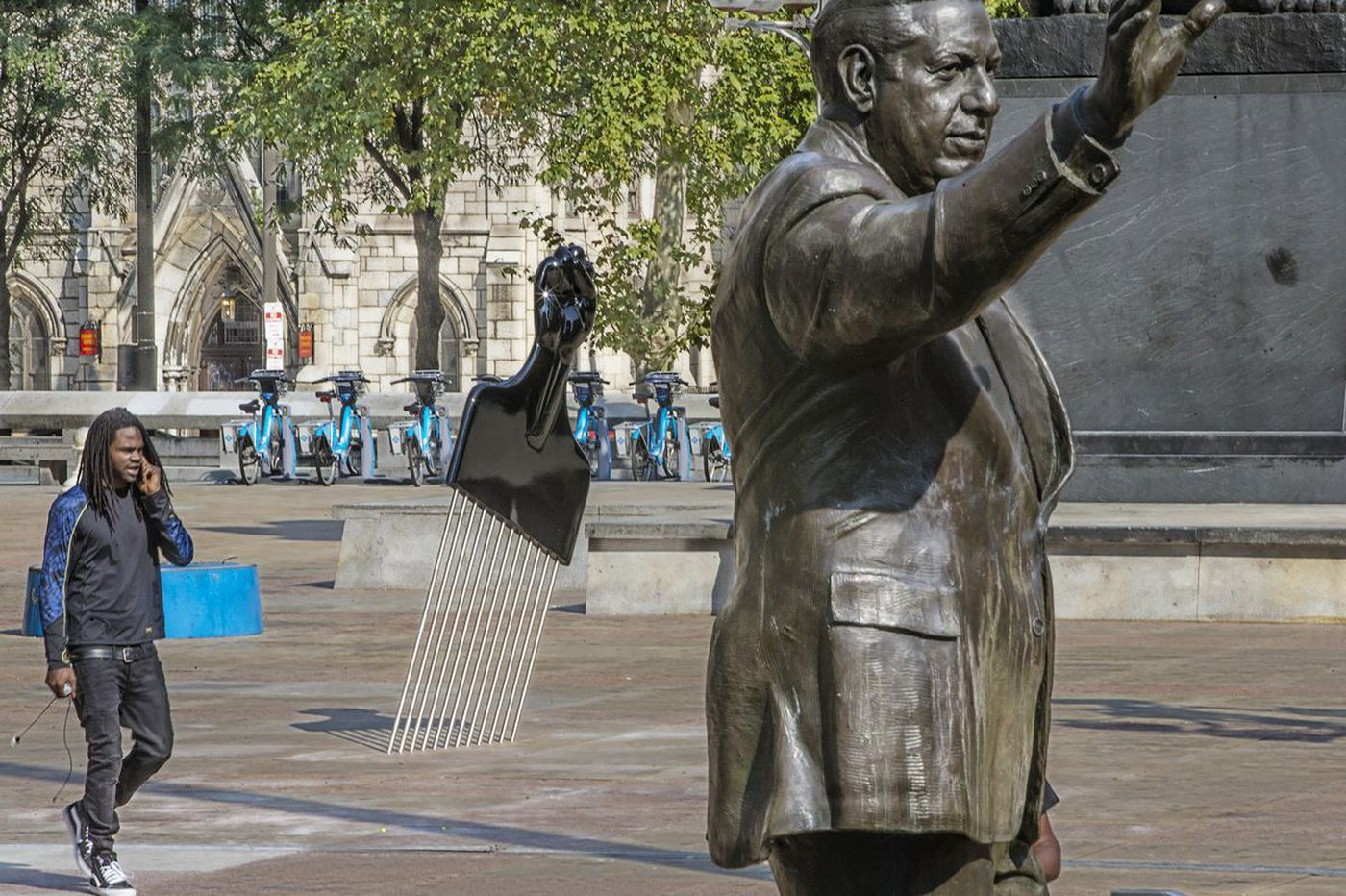 Afro-pick sculpture behind Rizzo statue is anything but empowering
