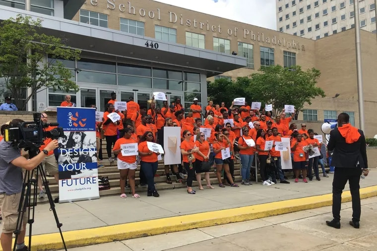 Supporters of the Charter School for Architecture and Design, or CHAD, rally on the Philadelphia School District steps before a recent School Reform Commission meeting. The SRC voted to begin nonrenewal proceedings against the school.