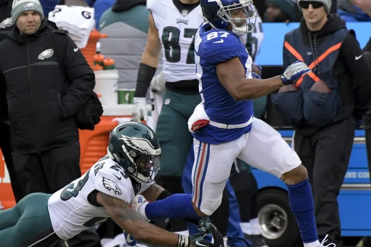 New York Giants wide receiver Sterling Shepard avoids a tackle by free safety Rodney McLeod on his way to score a touchdown during the first half of the Eagles' 34-29 win on Sunday.