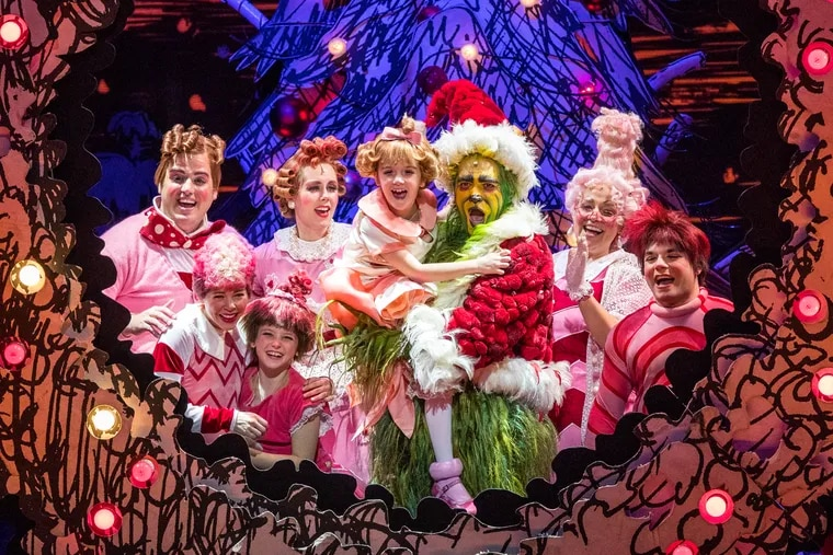 """The cast of """"Dr. Seuss' How the Grinch Stole Christmas! The Musical,"""" through Dec. 29 at the Merriam Theater."""