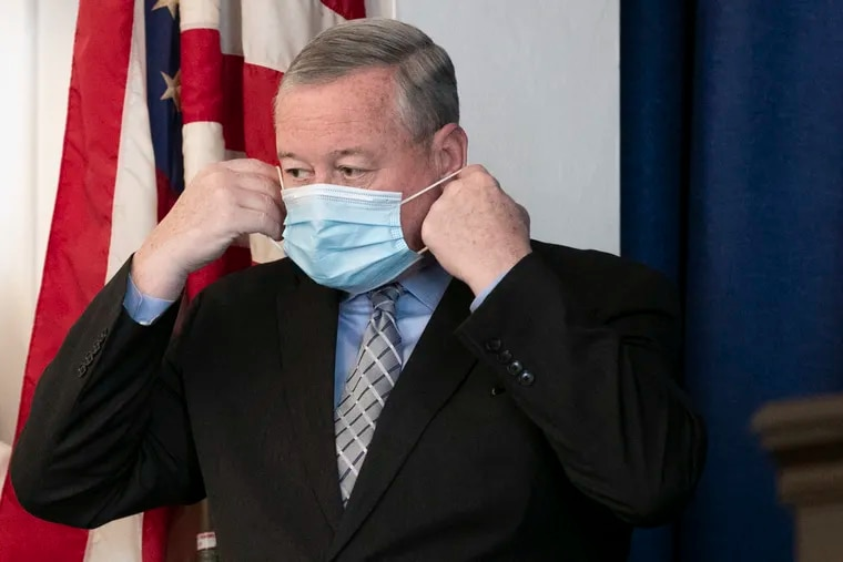 Mayor Jim Kenney puts on his mask during a press conference on May 19, 2021.