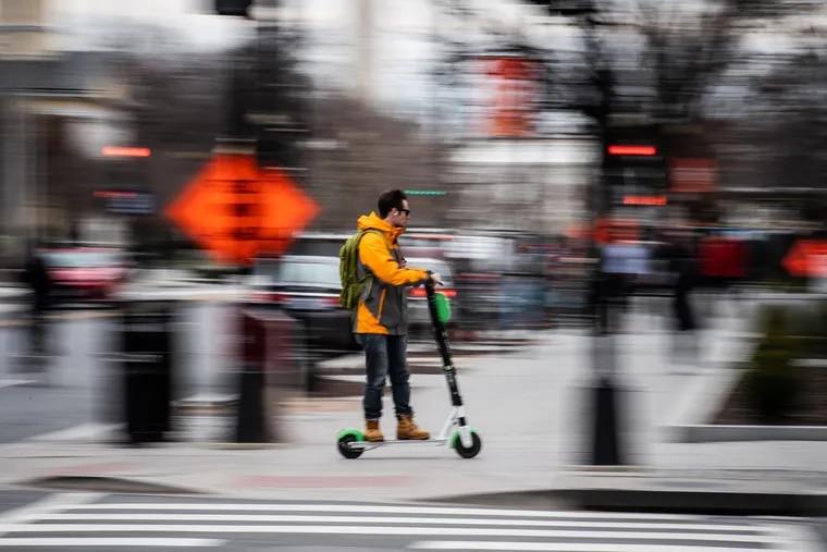 An e-scooter zips along a Washington, D.C., street.