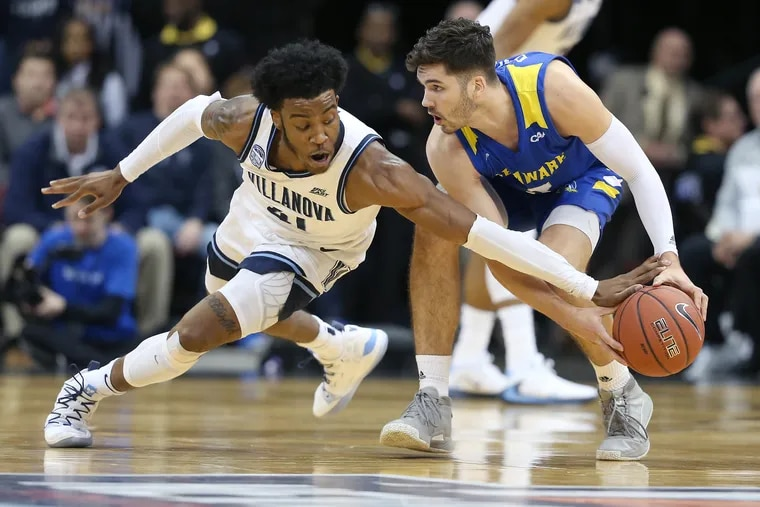 Saddiq Bey (left) of Villanova, tries to steal the ball from Nate Darling (right) of Delaware during the 1st half of the Never Forget Tribute Classic at the Prudential Center in Newark, N.J. on Dec. 14, 2019.
