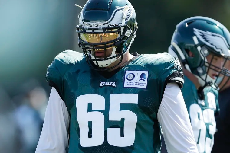 Eagles offensive tackle Lane Johnson wears a shield during training camp at the NovaCare Complex last month.