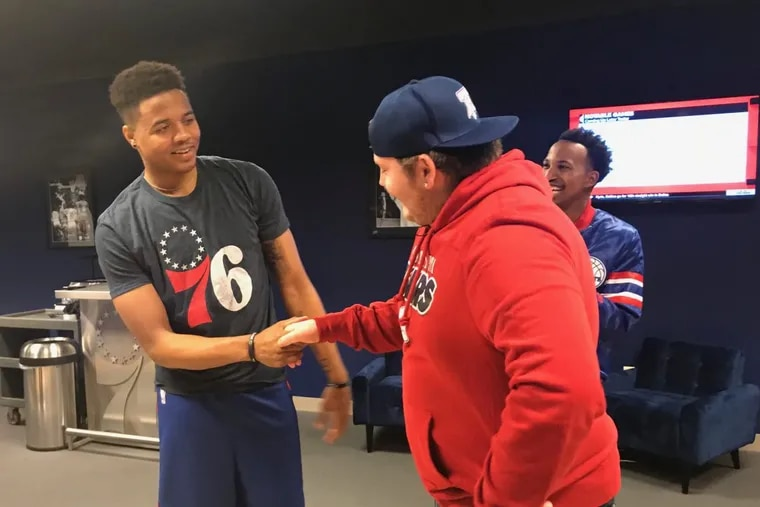 Mike Shelly, 17, of Newtown Square, meets 76ers point guard Markelle Fultz Monday.