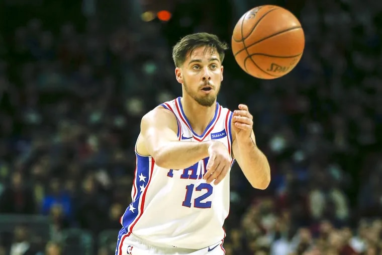 Sixers guard T.J. McConnell passes the basketball against the Orlando Magic on Saturday, November 25.