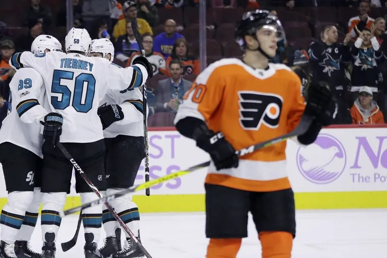 San Jose's Chris Tierney (50) celebrates with his teammates as Danick Martel (70) looks on dejectedly in the Flyers' 3-1 loss Tuesday.