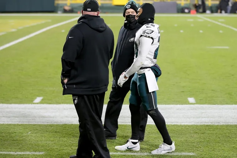 Eagles cornerback Darius Slay walks slowly off the field after he was injured against the Packers last Sunday.