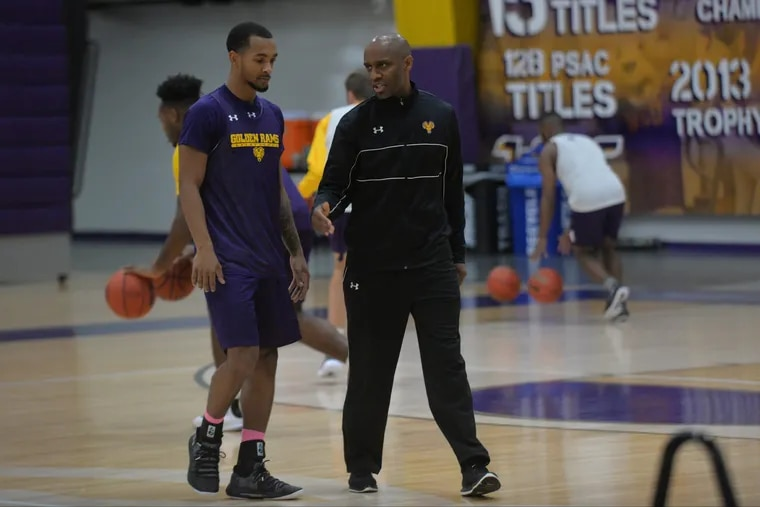 West Chester guard Malik Jackson with coach Damien Blair during a team practice on Wednesday.
