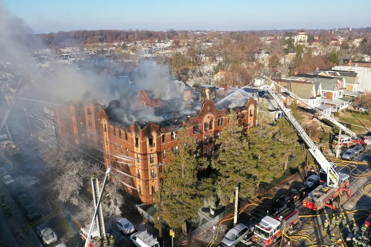 An aerial view shows the five-alarm fire in four-story apartment building at 63rd and Jefferson in the Overbook section of Philadelphia on Monday.