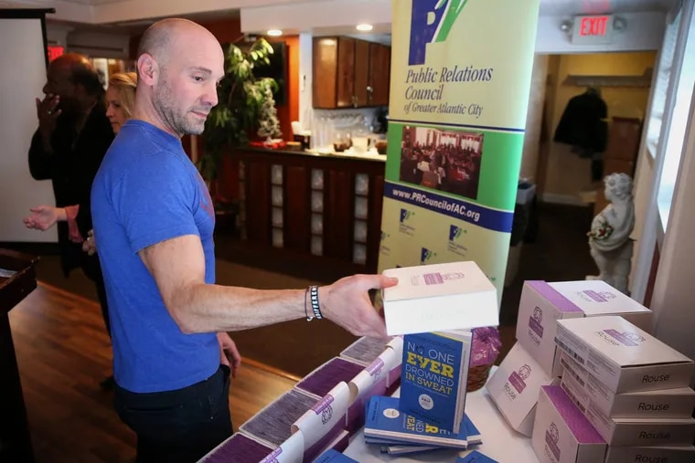 Scott Petinga holds a box of Rouse condoms during a Public Relations Council of Greater Atlantic City meeting at Angelo's Fairmount Tavern in Atlantic City, N.J., on Tuesday, Nov. 28, 2017. Petinga donated 50,000 condoms from his company to the South Jersey AIDS Alliance. TIM TAI / Staff Photographer
