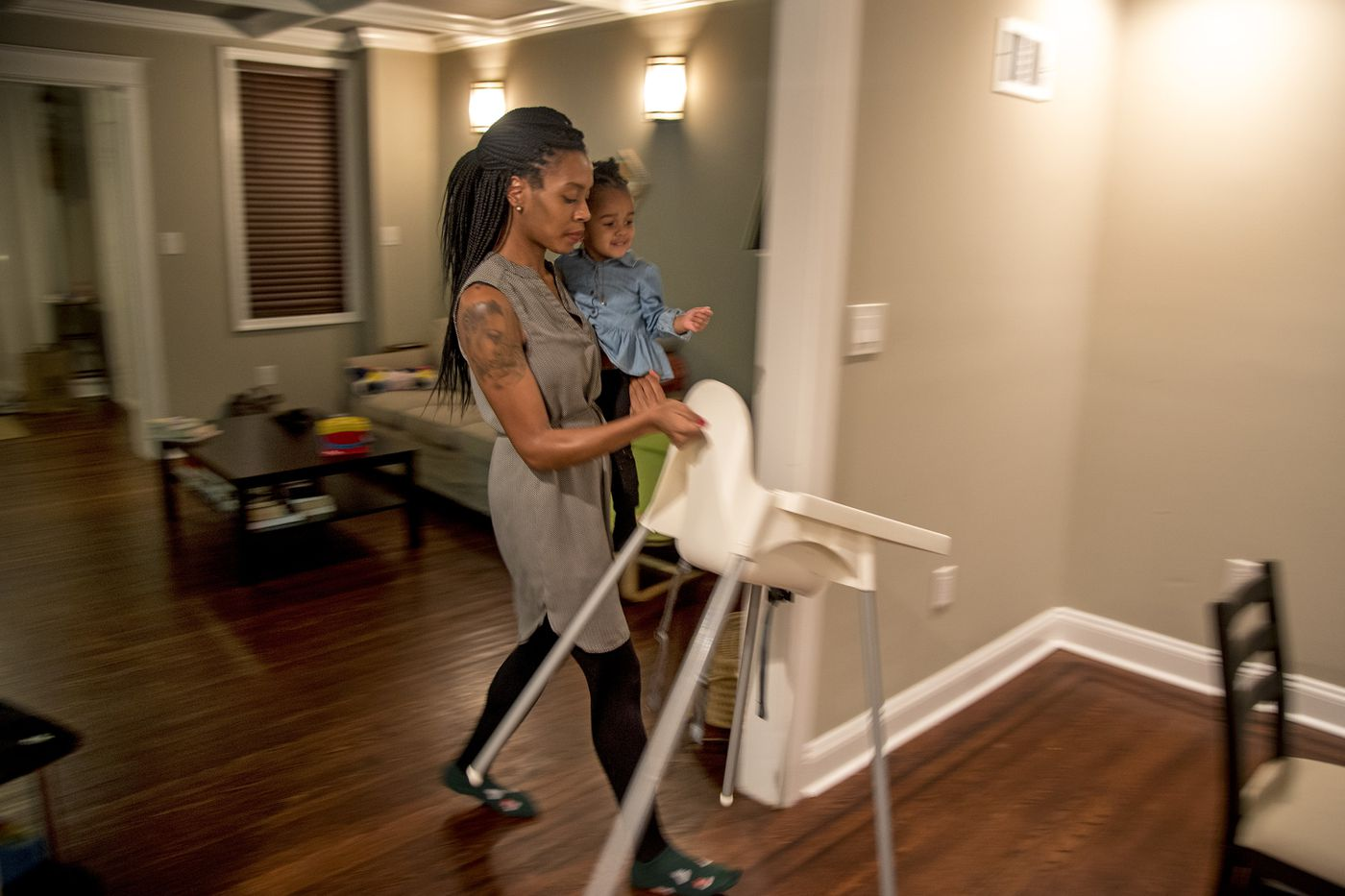 Auriel Dickey and her 2-year-old daughter Oma Smith prepare for dinner at home. After Oma's birth, Dickey experienced postpartum depression and eventually got connected to therapy through her employer.