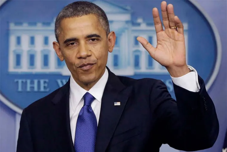 President Obama waves as he leaves the podium after speaking about the fiscal cliff on Friday. (AP Photo)