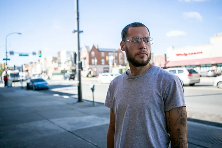 """Drew Raymond, 29, has been sleeping - and using heroin - on the streets around Broad and Snyder Streets in South Philadelphia. On Friday, he sought help from outreach workers. """"I am tired of living this life."""" He said he would use a supervised injection site, if one were made available."""