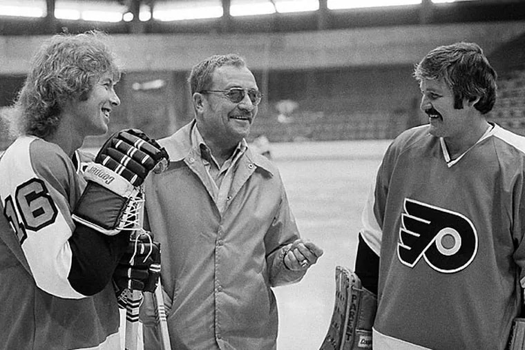 Hockey Hall of Famers Bobby Clarke, left, and Bernie Parent, right, talk with coach Fred Shero, HOF class of 2013. (AP Photo/Bill Ingraham)