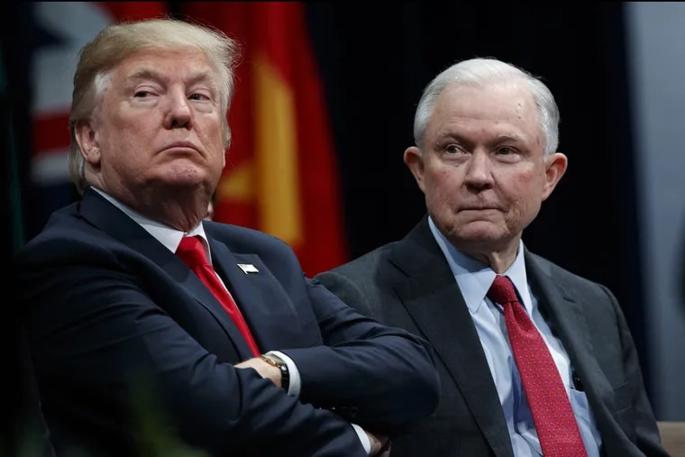 President Trump sits with Attorney General Jeff Sessions during the FBI National Academy graduation ceremony in Quantico, Va., in 2017.
