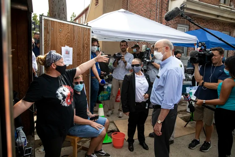 """Heather Cosenza of Bridgeport speaks with Gov. Tom Wolf on Wednesday and shows him the donations she's gathered for her neighbors affected by the flooding. """"I'm tired,"""" Cosenza said. """"Nobody helped us. We've been out here day and night."""""""