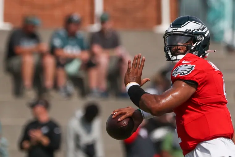 Eagles quarterback Jalen Hurts throws the ball during a drill at training camp at the NovaCare Complex in South Philadelphia on Saturday, Aug. 7, 2021.