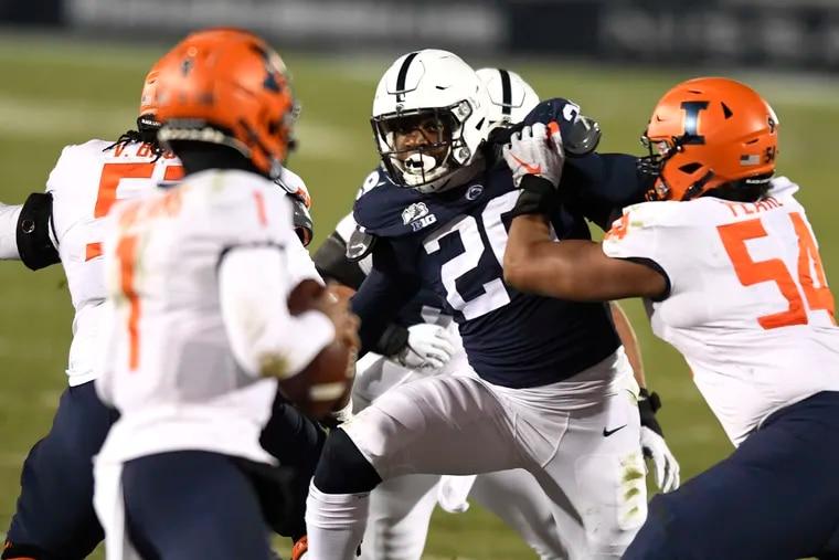 Penn State defensive end Adisa Isaac (20) pressures Illinois quarterback Isaiah Williams (1) during an a game last season.