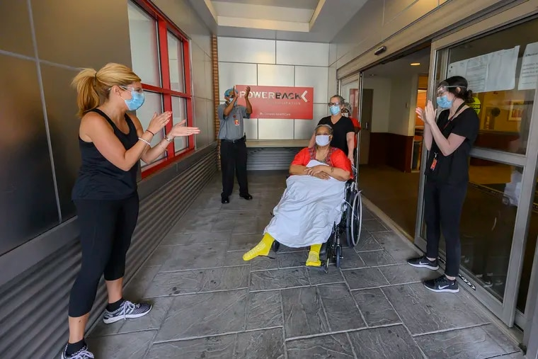 Veronica Alexander, 61, is given the traditional clap out as she is wheeled on Aug. 8 from Powerback Rehabilitation after spending a month in the hospital and 30 days at the rehab facility recovering from COVID-19.