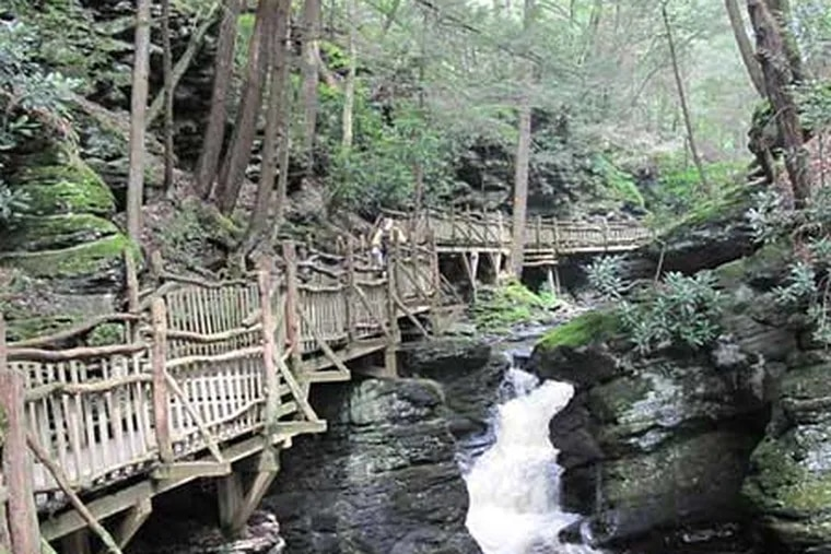 A wooden trail along a small waterfall and stream at Bushkill Falls in the Pocono Mountains.
