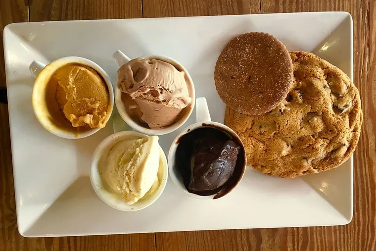 Ice creams, from left next to cookies at Metropolitan Bakery: Pumpkin, vanilla, malted milk chocolate, and a deeply intense dairy-free chocolate sorbet.