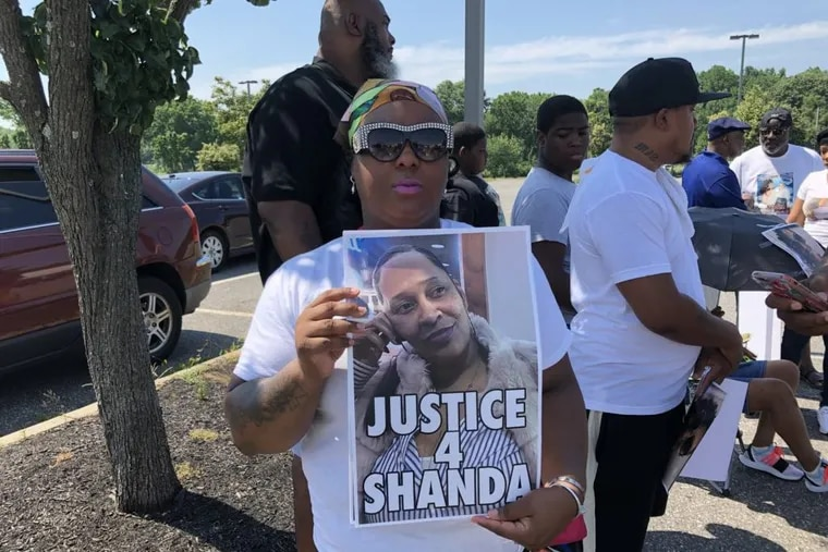 The family of LaShanda Anderson, a shoplifting suspect who was fatally shot by a Deptford Police officer last month, protest at the strip mall Sunday where the shooting occurred, demanding criminal charges against the police officer and disputing police accounts of the incident.