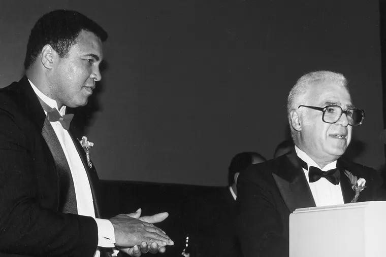 Stan Hochman (right) with Muhammad Ali, circa 1991.