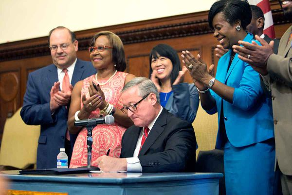 Kenney signs sugary drink tax into law