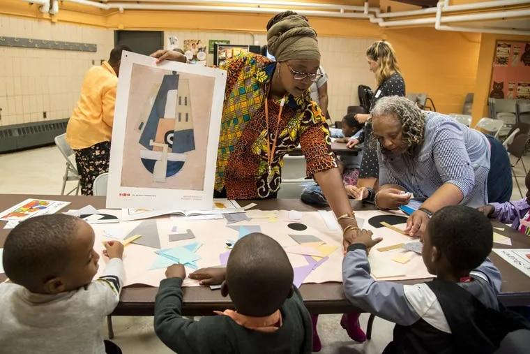 "Jihan Thomas, Barnes Foundation K-3 grade outreach coordinator, uses a replica of Marsden Hartley's ""Movement, Bermuda"" as a teaching tool for pre-K kids in the Community Concerns No. 13 program at Mander Recreation Center."