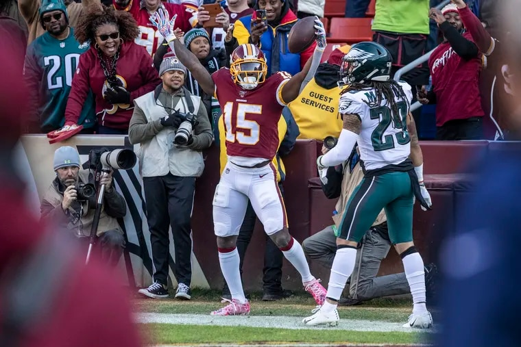 Washington Redskins receiver Steven Sims (left) celebrates his second-quarter touchdown catch over Avonte Maddox in the Eagles' 37-27 win Sunday at FedEx Field.
