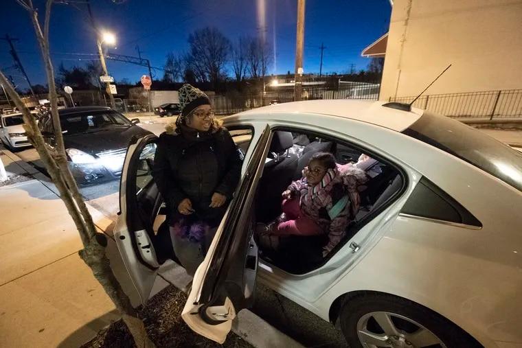Teeyrah Thomas and her daughter Jordyn Thomas, 5, get into their car at the Mercy Neighborhood Ministries of Philadelphia.