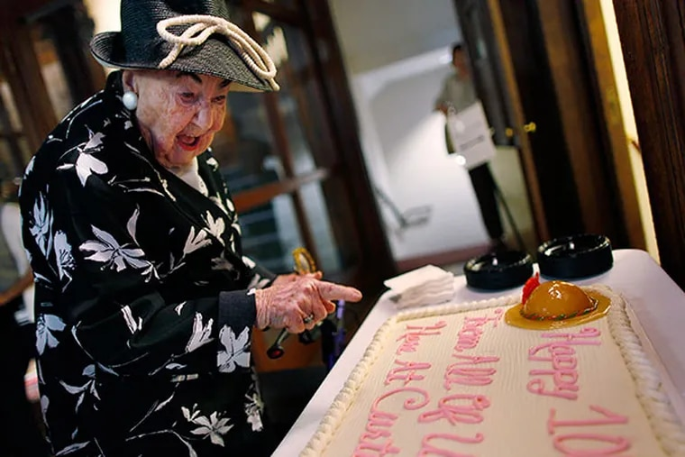 Eleanor Sokoloff, the piano teacher at Curtis Institute of Music, reads her birthday cake on May 6, 2014. She turns 100 this year. ( MICHAEL S. WIRTZ / Staff Photographer )
