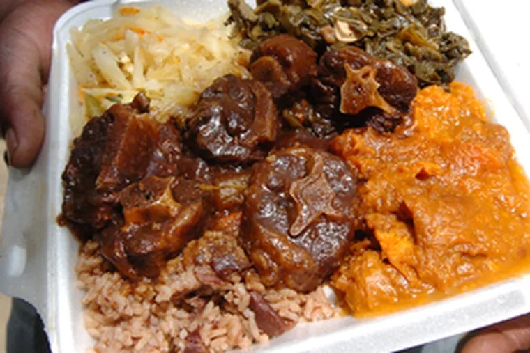 A platter of stewed oxtails , marinated overnight and simmered for two hours.