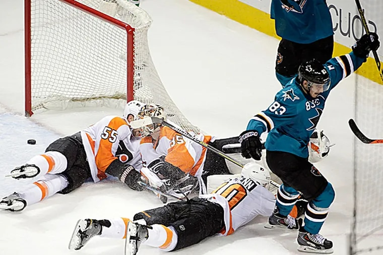 Sharks left wing Matt Nieto scores the game-winning goal on Flyers goalie Steve Mason during the third period. (Marcio Jose Sanchez/AP)