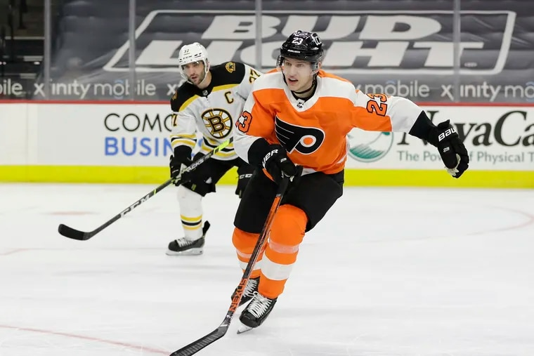 Flyers left winger Oskar Lindblom, shown against Boston on Feb. 5, and Scott Laughton became the sixth and seventh players on the team's COVID-19 list Friday.