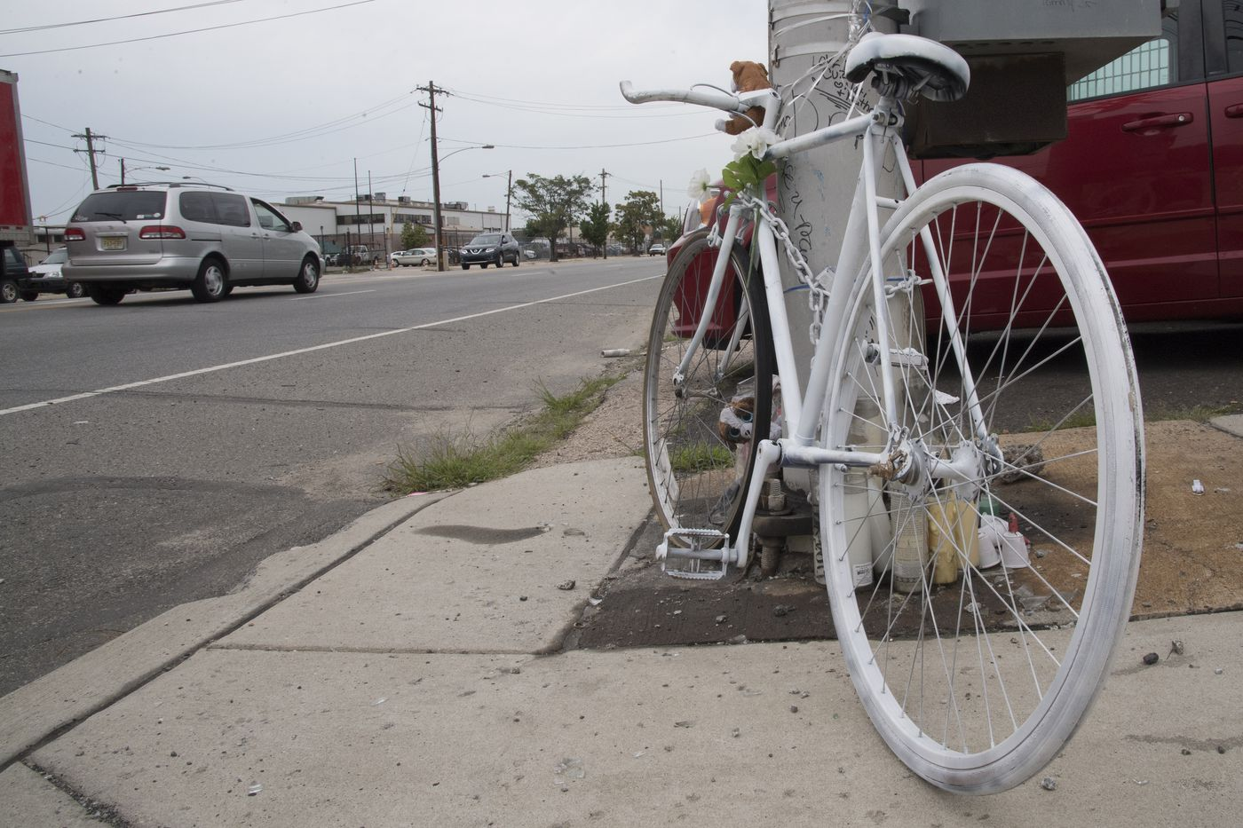 A white painted bike serves as a memorial for a cyclist killed at the intersection of Whitaker Avenue and Luzerne Street in Philadelphia.