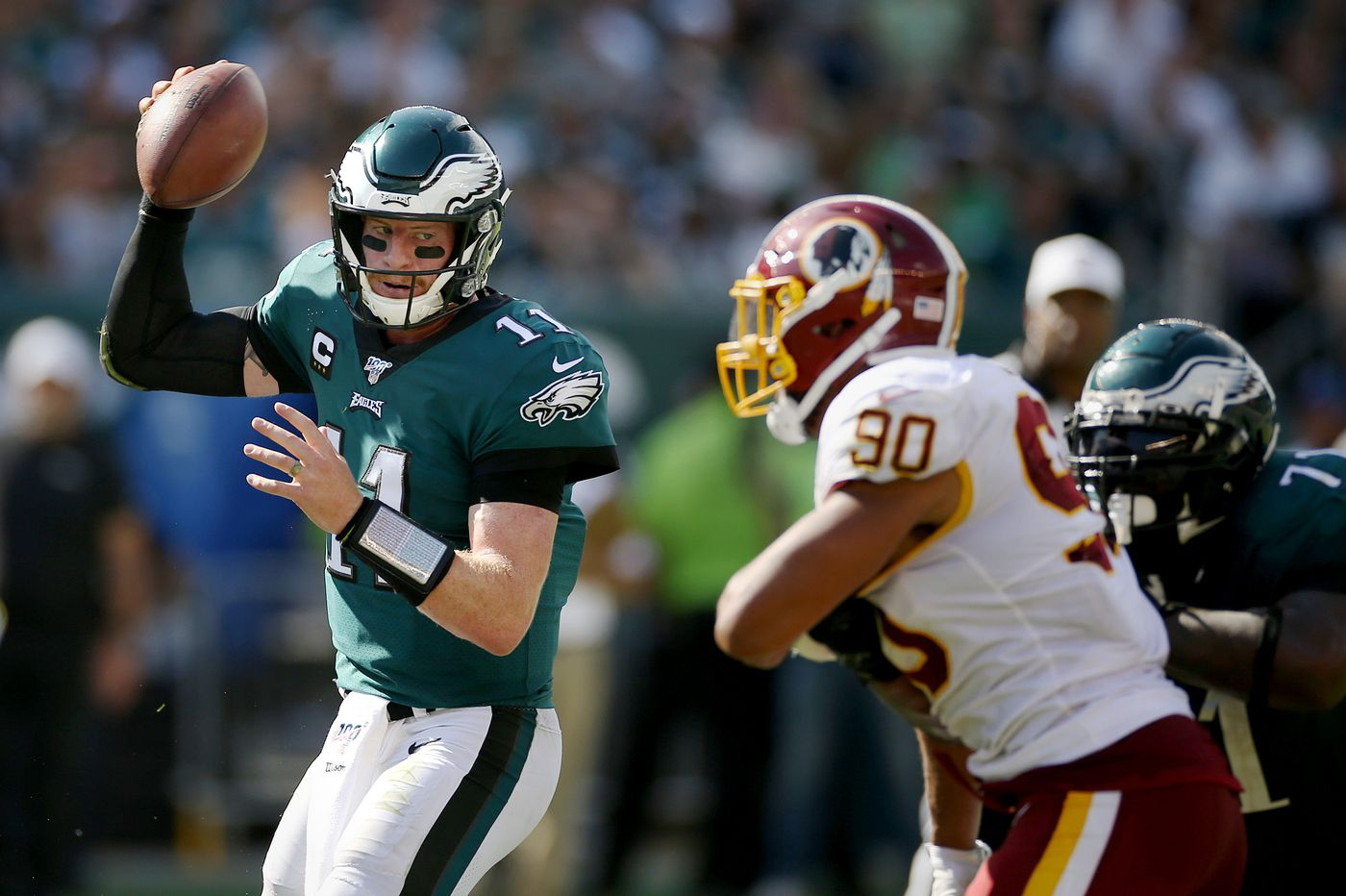 Eagles' Carson Wentz was effective on the move Sunday, which was fine with his coaches