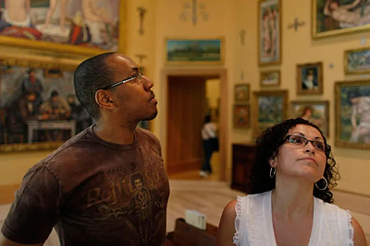 File photo: Abrose Crenshaw , 36, of Philadelphia and Saudy Carrera, 35, of Allentown, study paintings in the main gallery at The Barnes Foundation, which opened in Philadelphia in May. (MICHAEL S. WIRTZ/Staff Photographer)