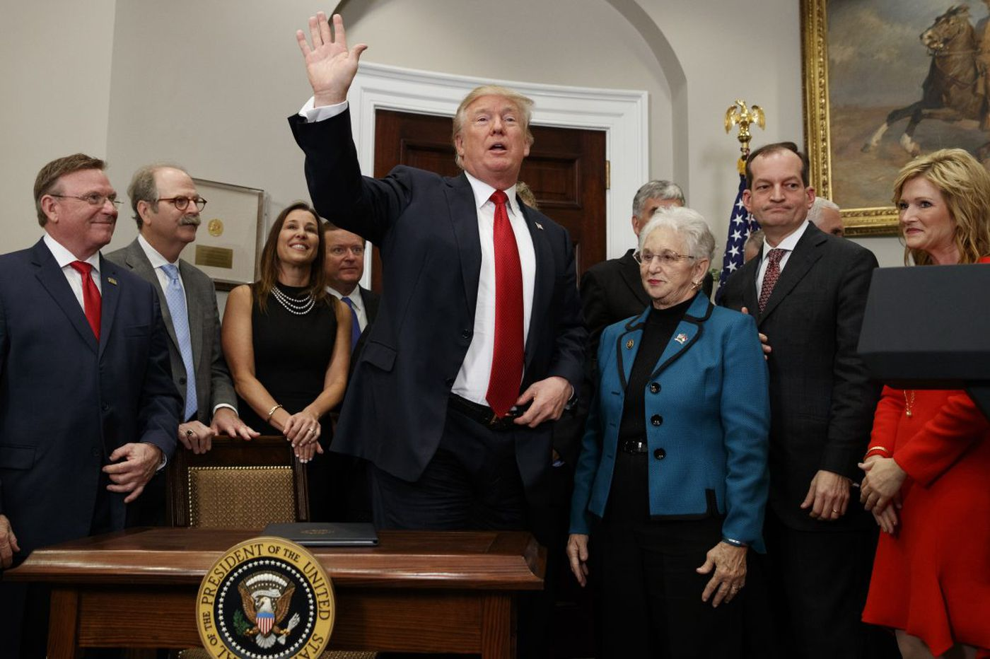 In consequential week, Trump uses pen to shape immigration, health care, Iran deal