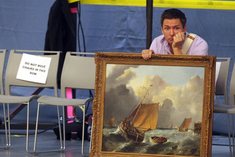 Greg of Akron, Ohio, waits to find out if his appraisal of his painting will be filmed backstage at the Antiques Roadshow 2015 summer tour in Cleveland on Saturday, July 11, 2015. (Mike Cardew/Akron Beacon Journal/TNS)