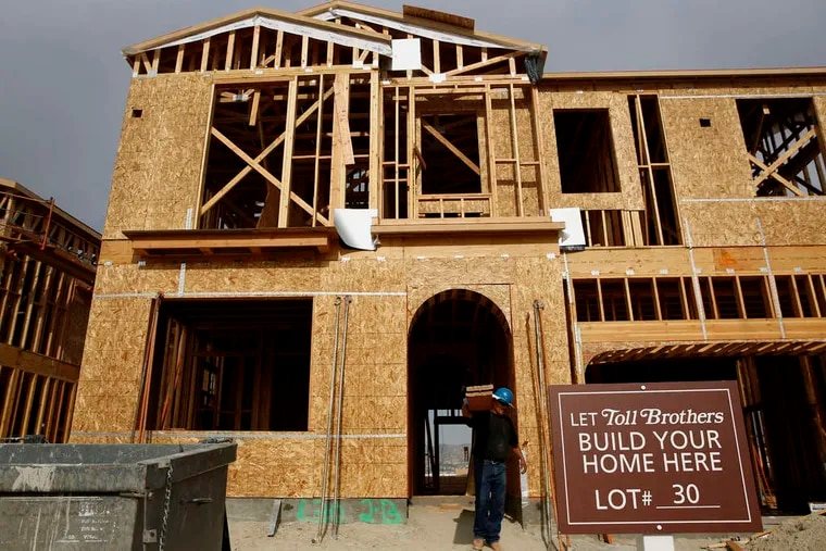 A new home goes up at the Baker Ranch development in Lake Forest, Calif., southeast of Los Angeles. New-home sales soared 7.8 percent, to a 539,000 annualized pace in February - a seven-year high, the government said, exceeding even the most optimistic of economists' forecasts. Homebuilders' stocks reflected the upbeat results, with Toll Brothers Inc. rising 57 cents, or 1.49 percent, Tuesday.