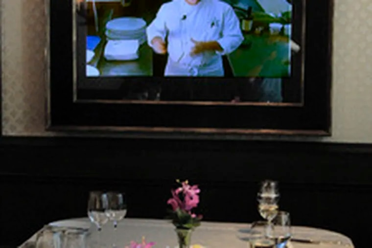 Executive chef Martin Hamann speaks with diners who can watch him preparing their meal in the kitchen.