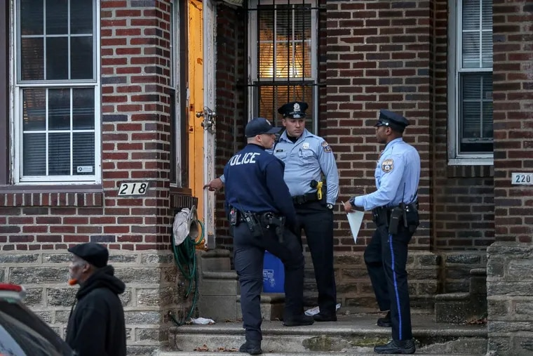Philadelphia Police Department officers stand outside a home where a 2-year-old was found with a gunshot wound to the head in the 200 block of West Godfrey Avenue in Olney on Thursday, Nov. 9, 2017. A family member drove the child to Einstein Hospital, where he was pronounced dead.
