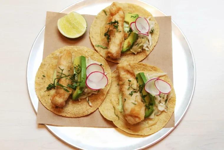 The mahi mahi tacos at Mission Taqueria have thick-cut bars of fish crisped inside a delicate rice flour batter.