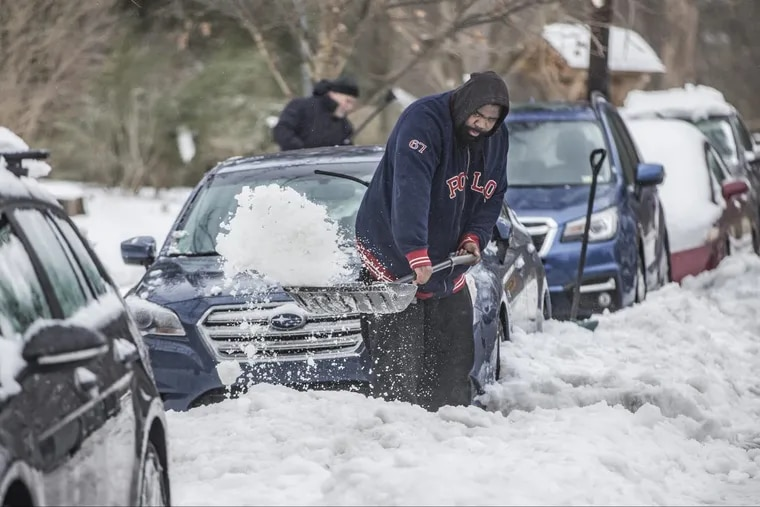 Bernard Stephens helps a friend shovel out his car in Mount Airy last winter. Could new research from Drexel University have made his job easier?